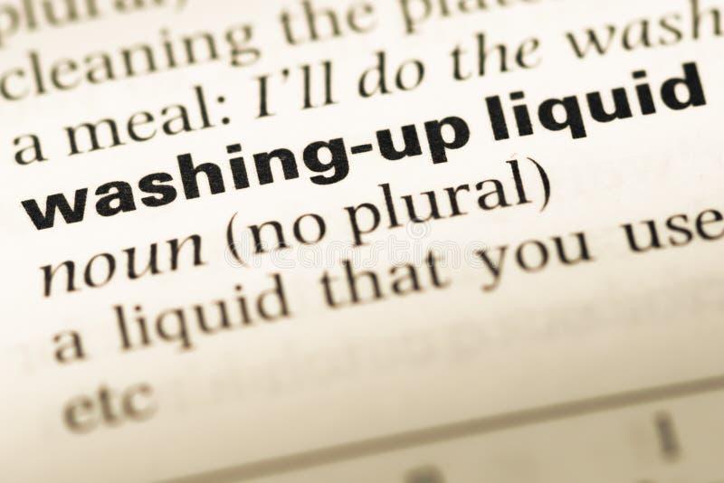 Fermez-vous de la vieille page anglaise de dictionnaire avec le lavage de mot vers le haut du liquide photos libres de droits