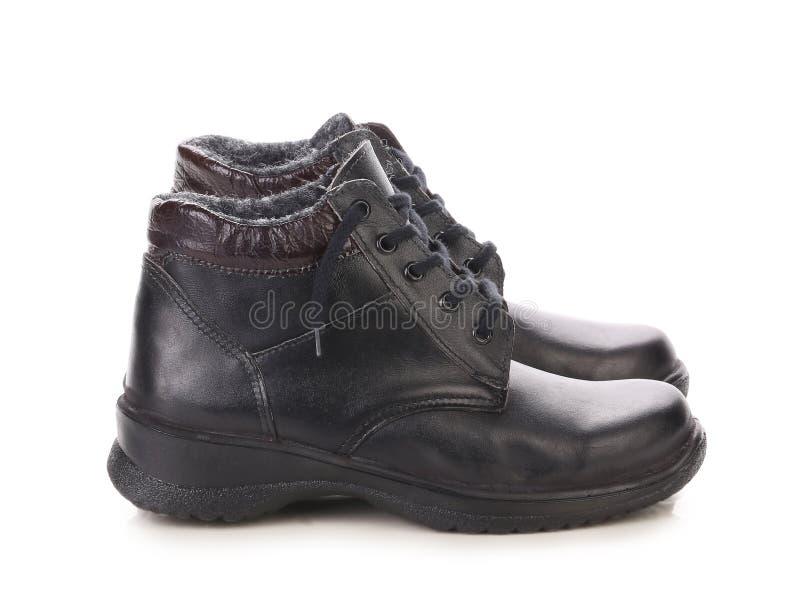 Fermez-vous des bottes de l'homme d'hiver. image libre de droits