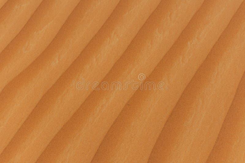 Fermez-vous des modèles de sable images stock
