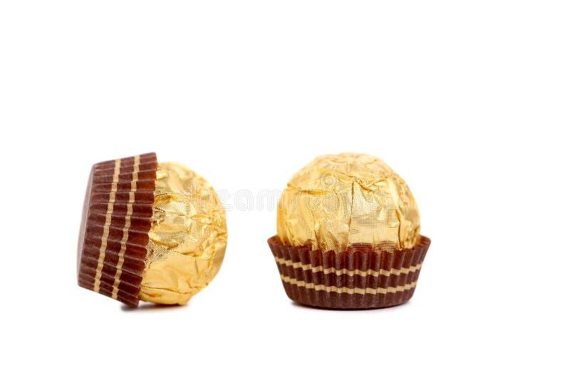 Fermez-vous du bonbon de chocolat d'or. images stock