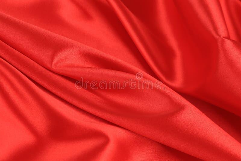 Fermez-vous du fond rouge de tissu en soie. photos libres de droits