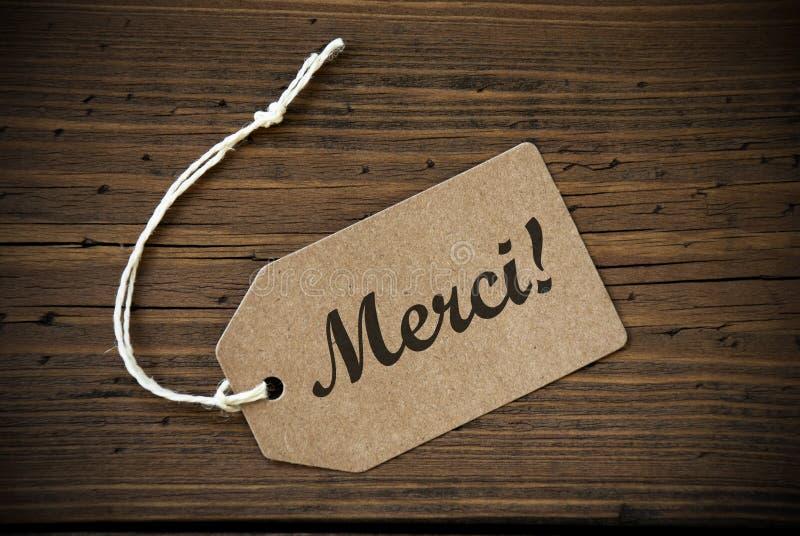 Fermez-vous du label avec le texte français Merci photo libre de droits