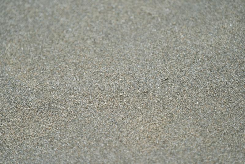 Fermez-vous et macro brun foncé et sable noir pour n'importe quel fond image stock