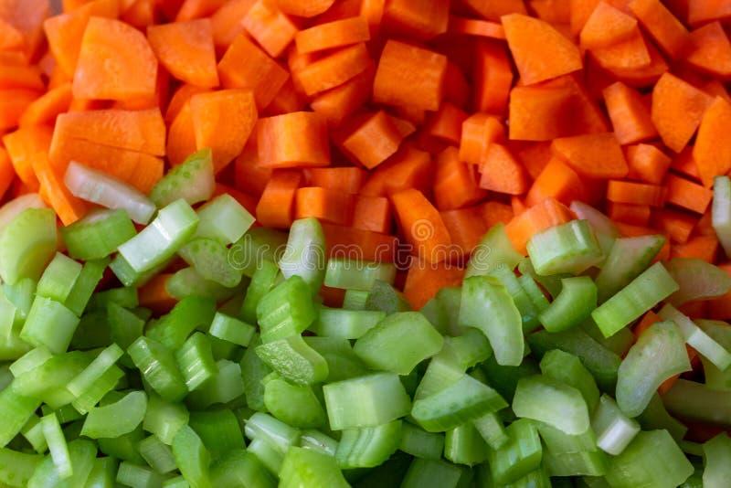 Fermez-vous sur les carottes et le céleri hauts découpés photo libre de droits