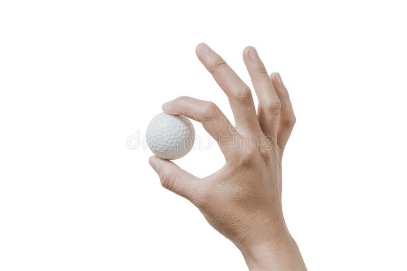 Fermez-vous vers le haut de la main tenant la boule de golf sur le fond blanc images libres de droits