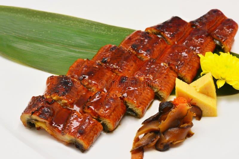 Fermez-vous vers le haut de la sauce de soja grillée par anguille japonaise image stock
