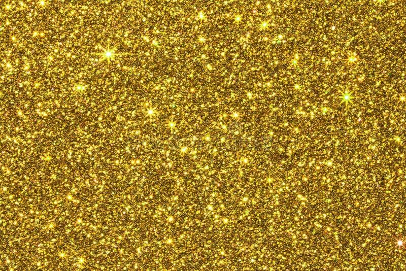 Fermez-vous vers le haut de la texture d'or de scintillement pour le fond de charme images stock