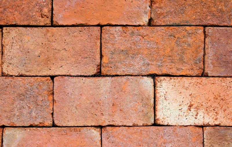 fermez-vous vers le haut de la texture de mur de briques et du fond de brique rouge avec la copie s image stock
