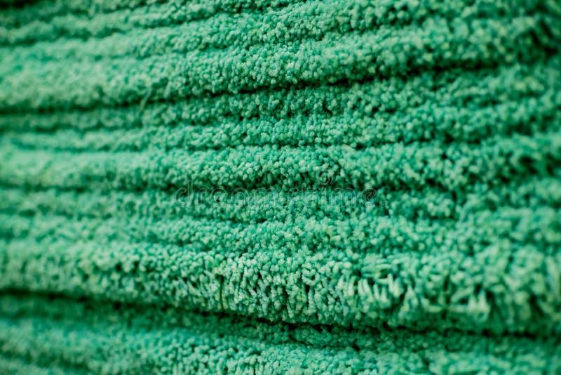 Fermez-vous vers le haut de la texture de tapis Pile de natte Foyer sélectif surface pelucheuse tapis hirsute vert mou de concept photographie stock libre de droits