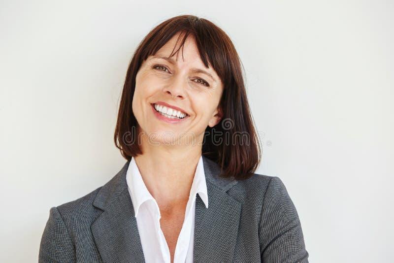 Fermez-vous vers le haut de la verticale du femme heureux d'affaires images stock