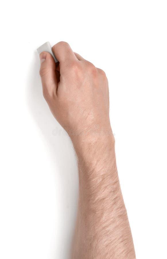 Fermez-vous vers le haut de la vue d'un man& x27 ; main de s jugeant une gomme d'isolement sur le fond blanc photo libre de droits