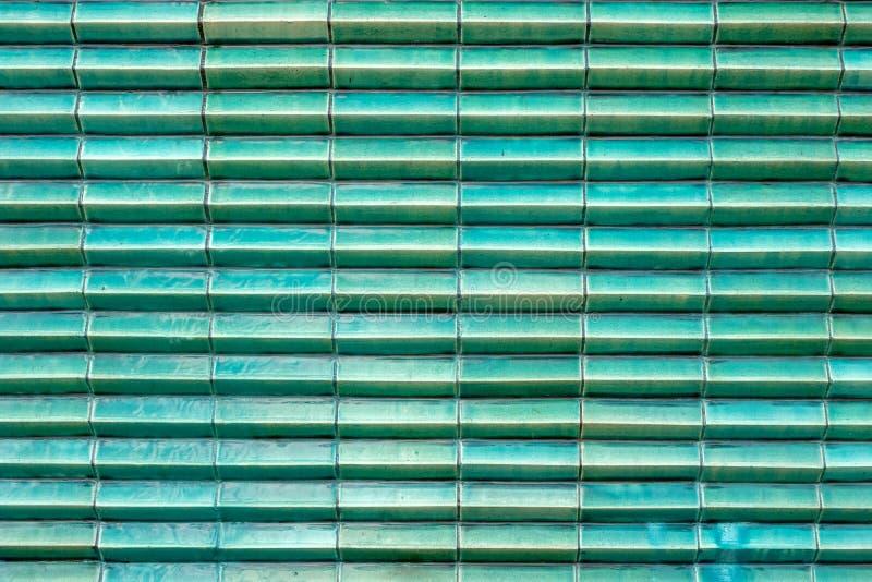 Fermez-vous vers le haut du bloc brillant de couche de structure de couleur de tuile de vert de turquoise photo stock