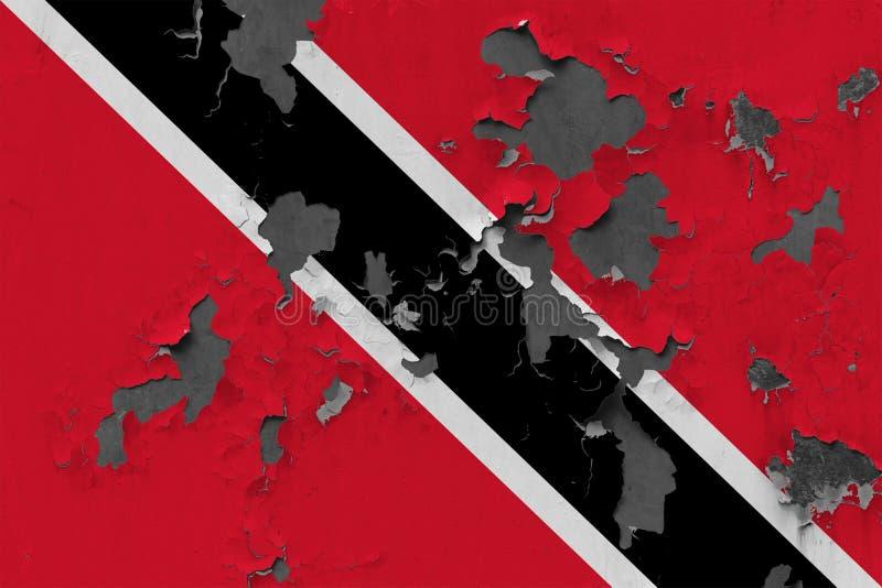 Fermez-vous vers le haut du drapeau sale, endommagé et superficiel par les agents de Trinidad And Tobago sur le mur épluchant out photographie stock libre de droits
