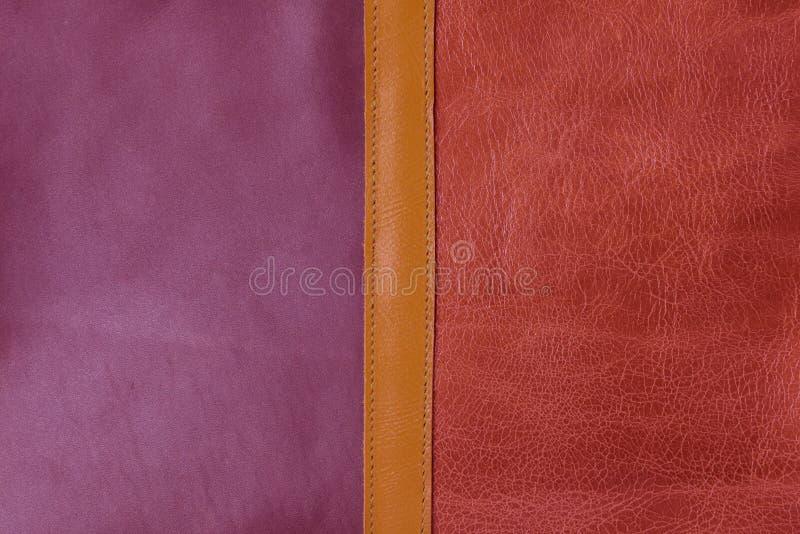Fermez-vous vers le haut du fond en cuir orange et pourpre de texture photographie stock