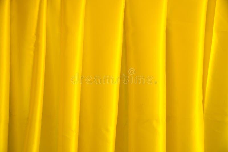 Fermez-vous vers le haut du fond jaune de texture d'abrégé sur tissu de velours côtelé photographie stock libre de droits