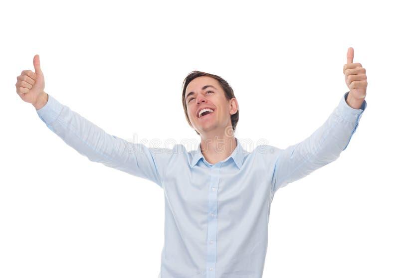 Fermez-vous vers le haut du portrait d'un homme réussi posant avec des pouces  images stock