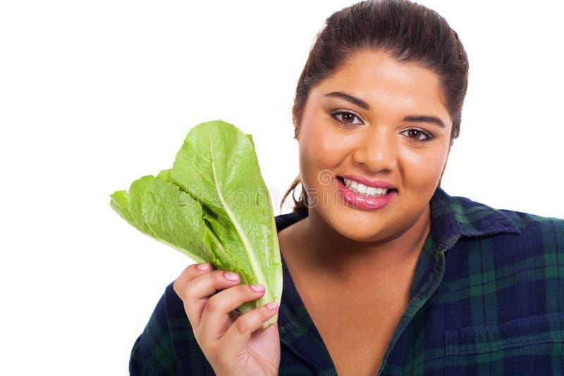 Laitue de poids excessif de fille image stock