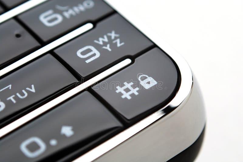 Fermez-vous vers le haut du projectile du clavier numérique mobile sous la lumière photos stock