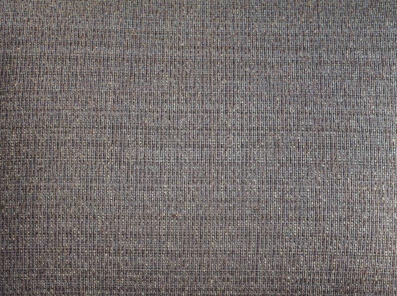 Fermez-vous vers le haut du sofa brun de tissu images libres de droits