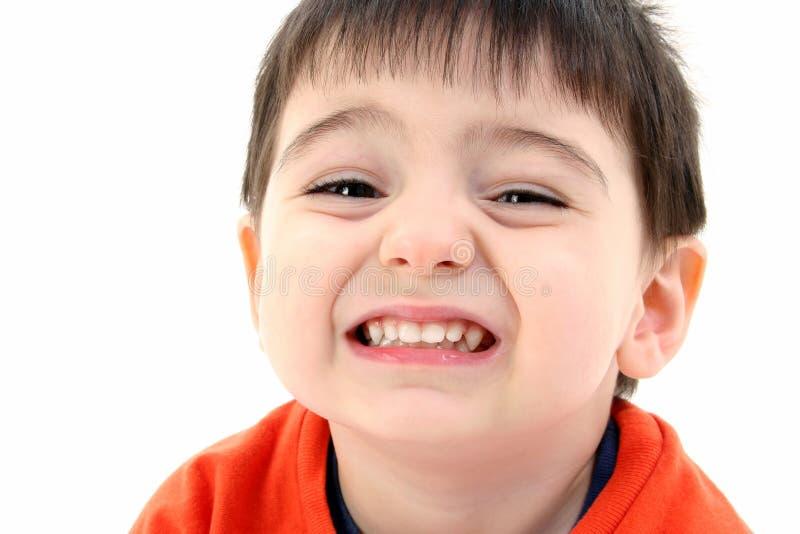 Fermez-vous vers le haut du sourire de garçon d'enfant en bas âge image stock