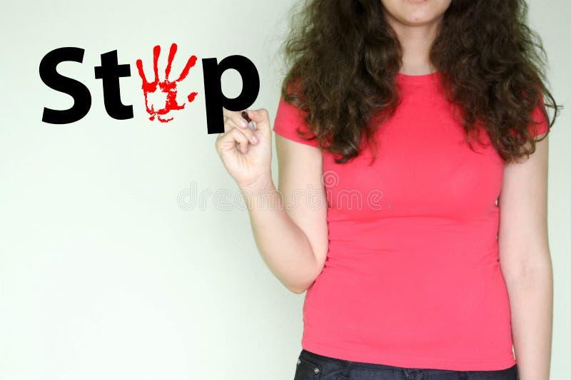 Fermi il concetto ragazza nel rosso con attenzione immagini stock libere da diritti