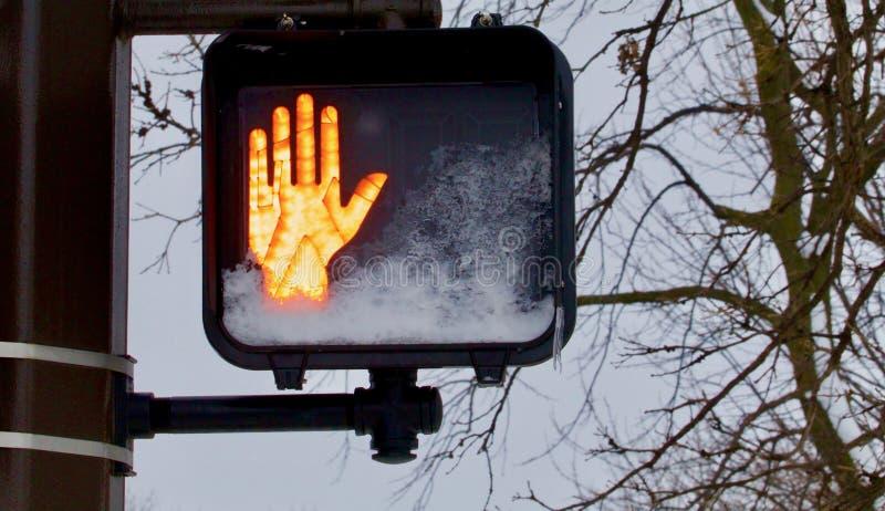 Fermi il simbolo leggero della mano fotografie stock