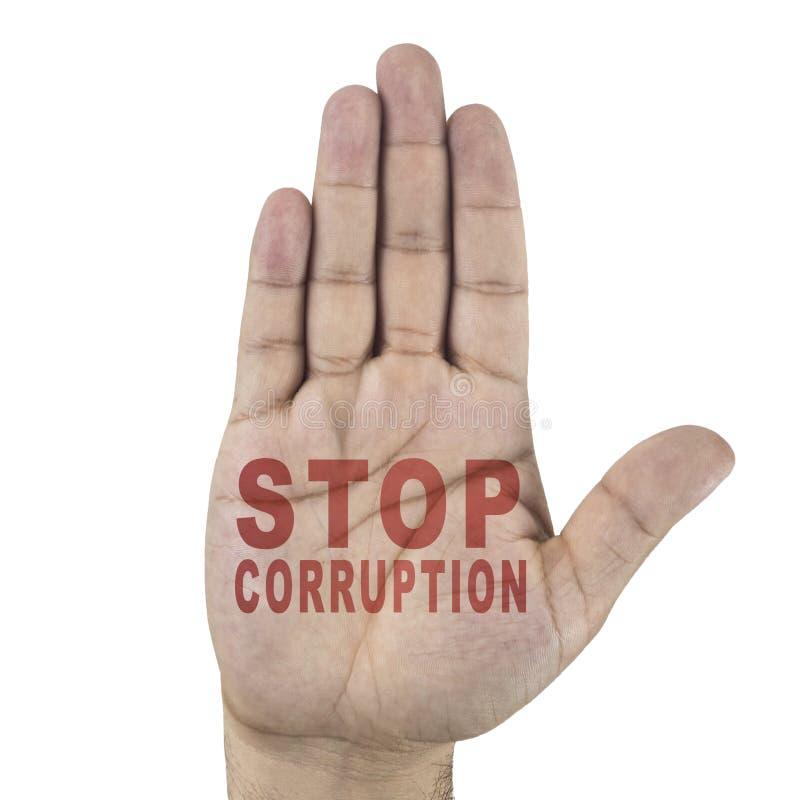 Fermi le parole della corruzione scritte sulla mano maschio del ` s Isolato su priorità bassa bianca fotografia stock libera da diritti