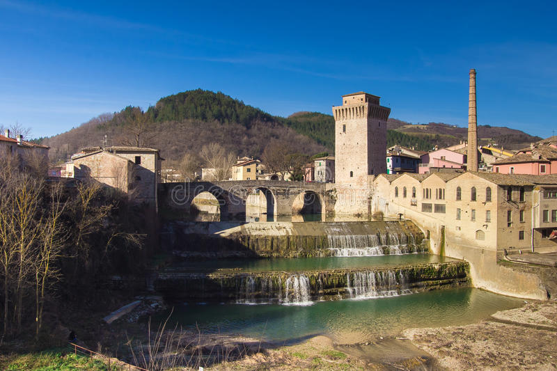 Fermignano medieval village with beautiful waterfall. Of Metauro river, Marche - Italy royalty free stock photos