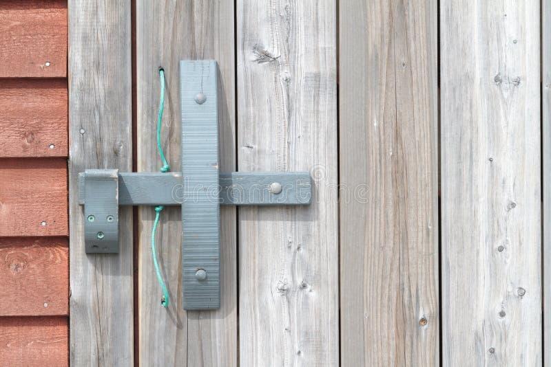 Fermo di porta di legno immagine stock libera da diritti