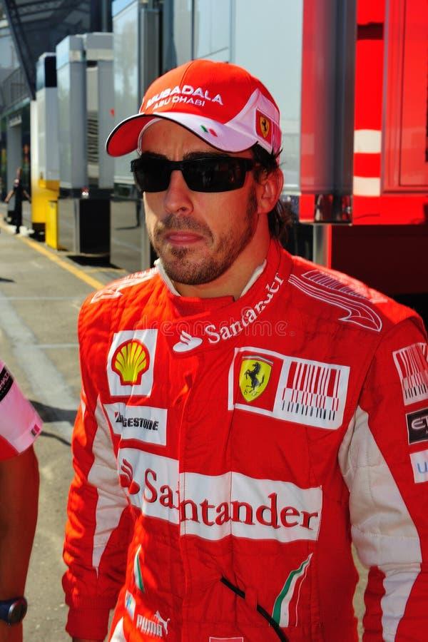 Fernando Alonso. Walking whit his to the pit lane stock image