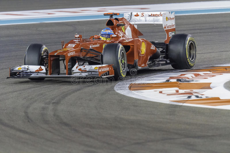 Fernando Alonso cornering a Ferrari F1 car at Yas Marina race track Abu Dhabi stock photos