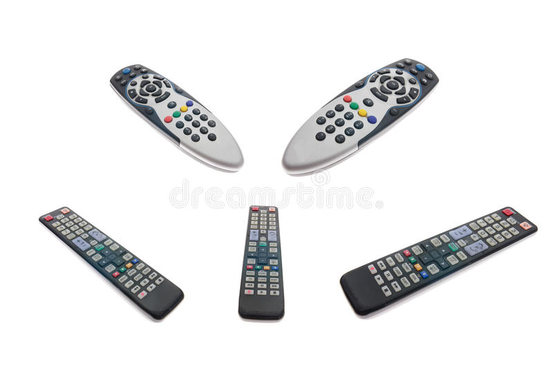 Fernsehfernbedienungen getrennt mit Ausschnittsänderung am objektprogramm stockfoto