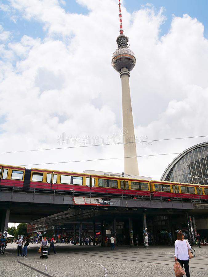 The Fernsehturm TV tower and the Railway Station in the Alexanderplatz in Berlin Germany. The Alexanderplatz district of Berlin is now a vibrant area with shops royalty free stock photos