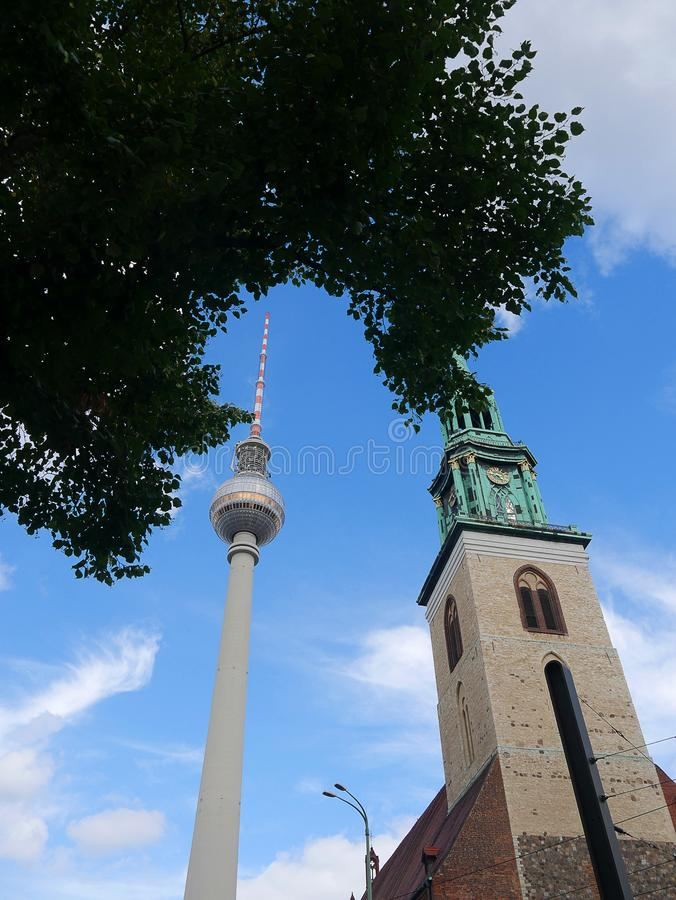 The Fernsehturm TV tower and the Railway Station in the Alexanderplatz in Berlin Germany. The Alexanderplatz district of Berlin is now a vibrant area with shops stock photos