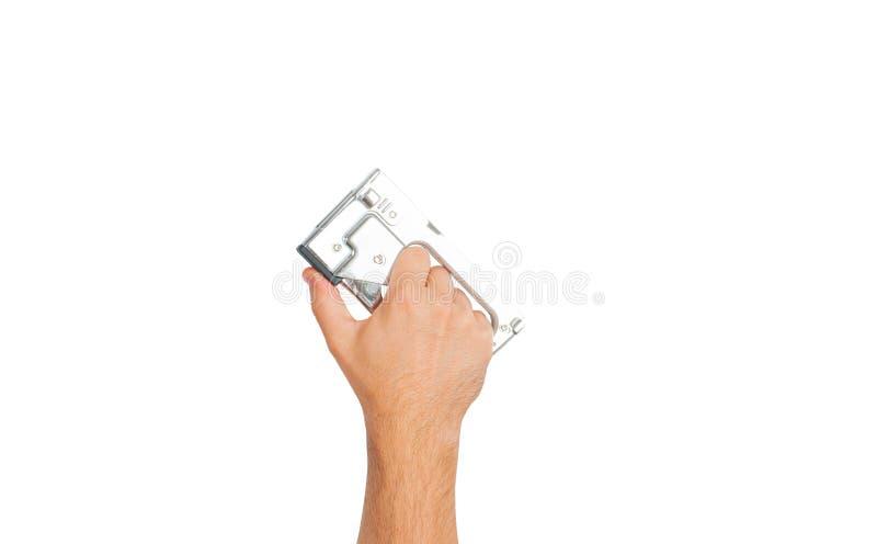 Ferramenta A mão está guardando o grampeador industrial em um fundo branco fotografia de stock