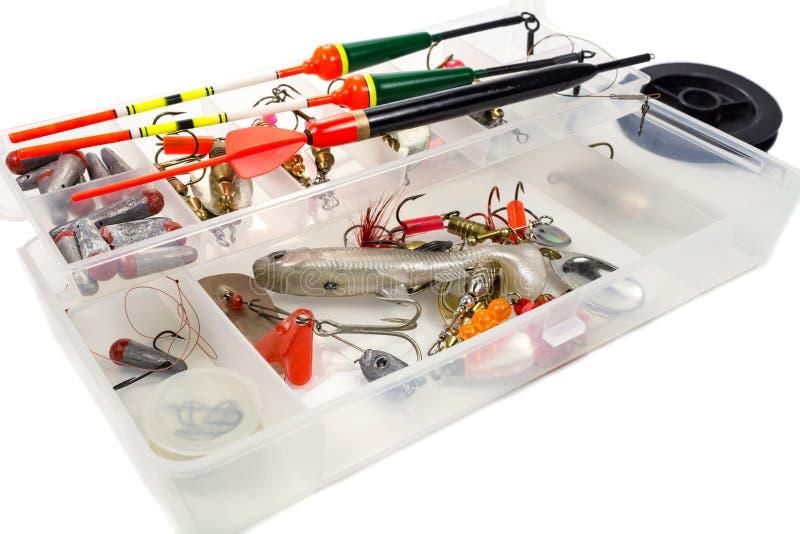 Ferramentas da pesca na caixa de armazenamento no fundo branco imagem de stock