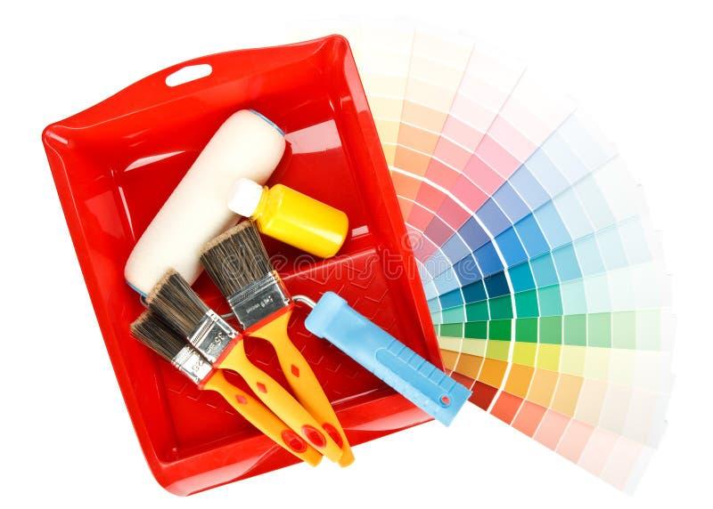 Ferramentas da pintura e guia da cor imagem de stock