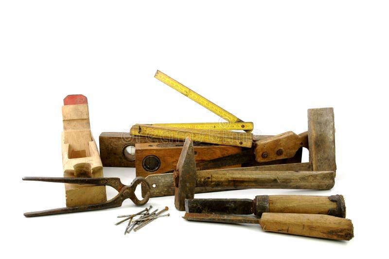 Ferramentas de madeira velhas do carpinteiro fotografia de stock