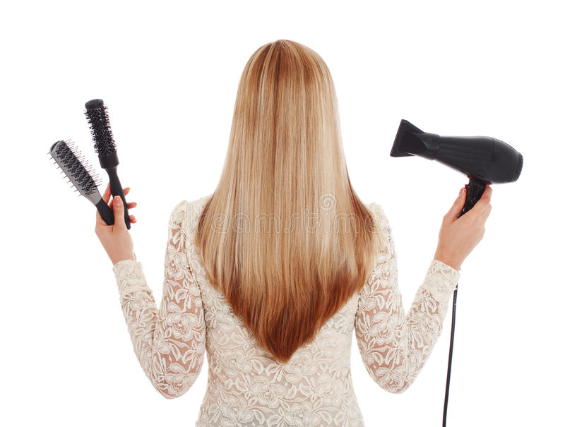 Ferramentas do cabelo louro e do cabeleireiro - imagem conservada em estoque imagem de stock