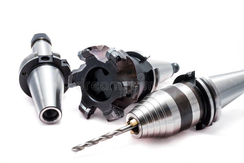Ferramentas/equipamentos de trituração com o suporte para a máquina do CNC imagens de stock royalty free