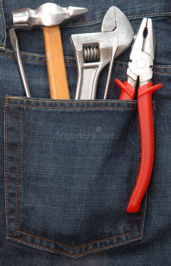 Ferramentas no bolso das calças de brim fotografia de stock royalty free