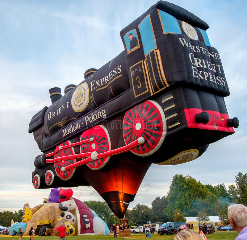 Ferrara, Italy 16 September 2016 - A Special Shapes hot air baloon inspired by the famous Orient Express train stock image