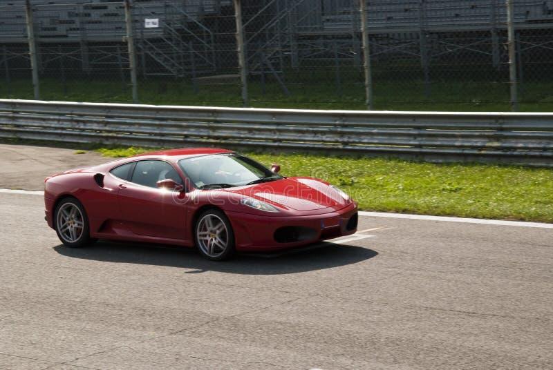 Ferrari at Autodromo di Monza. Ferrari F430 crossing the starting grid during Race Event at Autodromo di Monza 2009 - Italy stock images