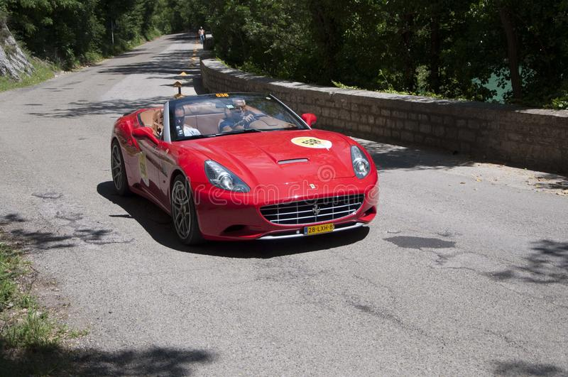 FERRARI CALIFORNIA2010 on an old racing car in rally Mille Miglia 2017 the famous italian historical race 1927-1957 on May 19 2 royalty free stock images