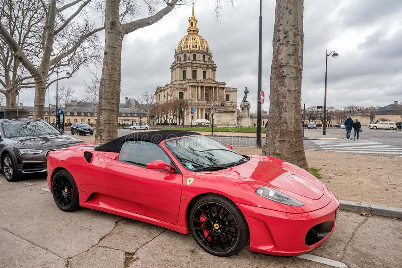 Ferrari car parked near Chapel of Saint Louis des Invalides in Paris, France stock photo