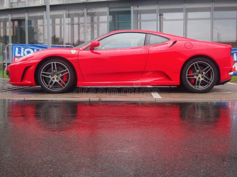 Ferrari F430 in the rain. VILNIUS, LITHUANIA-AUGUST 20, 2017: Red Ferrari F430 in the rain. This model is one of the most popular cars for Ferrari fans stock photo