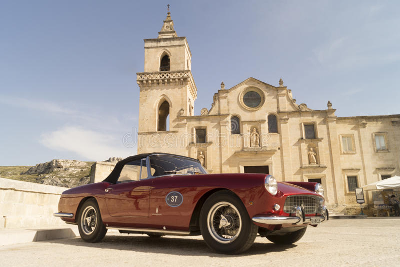 Ferrari GT in Matera. Luxurious Ferrari 250 GT Berlinetta, in the background the city of Sassi of Matera, Basilicata, Italy royalty free stock photo