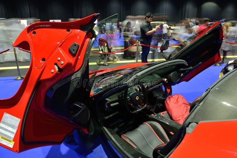 The Ferrari LaFerrari sportscar is on Boulevard of Dreams on Dubai Motor Show 2017 stock photos