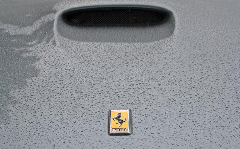 Ferrari logo on rainy bonnet stock photos