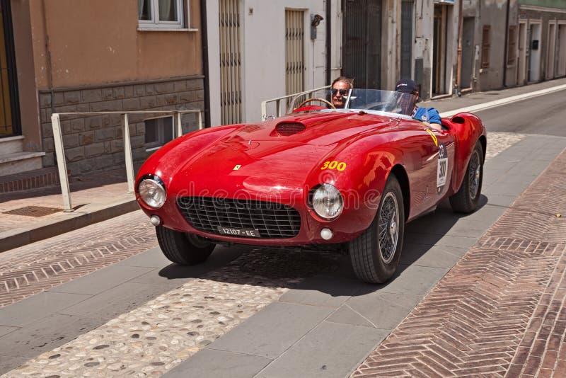 Ferrari 375 MM Spider Pinin Farina 1953 in Mille Miglia 2017. Driver and co-driver on a racing car Ferrari 375 MM Spider Pinin Farina 1953 in historical classic stock image